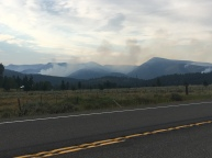 Smoke billowing out the mountains.